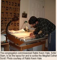 Rabbi Kevin Hale laying out the Megillat Esther scroll